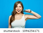 woman brushing teeth with... | Shutterstock . vector #1096256171