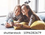 two cute smiling twins sisters... | Shutterstock . vector #1096282679