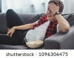laughing teenager with popcorn... | Shutterstock . vector #1096306475