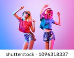 Stock photo two sexy fashionable dj girl dance colorful neon uv mixed light rave house music vibes slim 1096318337