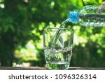 close up hand holding bottle to ... | Shutterstock . vector #1096326314