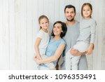 portrait of happy parents carry ... | Shutterstock . vector #1096353491