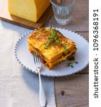 Small photo of Piece of pumpkin lasagne on plate