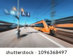 high speed orange train in... | Shutterstock . vector #1096368497