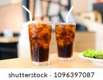 glass of cola with ice cubes | Shutterstock . vector #1096397087