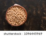 raw chickpeas in a ceramic bowl ... | Shutterstock . vector #1096445969