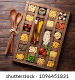 various pasta in wooden box.... | Shutterstock . vector #1096451831