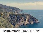 picturesque village rising... | Shutterstock . vector #1096473245