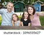 happy family outdoors with wood ... | Shutterstock . vector #1096535627