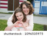 happy mother and daughter... | Shutterstock . vector #1096535975