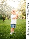 small child walks in the park... | Shutterstock . vector #1096540295