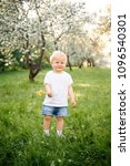 small child walks in the park... | Shutterstock . vector #1096540301