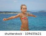Girl on the sea - stock photo