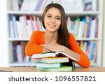 young female student in library | Shutterstock . vector #1096557821
