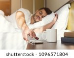 sleepy guy waking up early... | Shutterstock . vector #1096571804