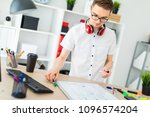 a young man in glasses stands... | Shutterstock . vector #1096574204