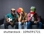 Small photo of group of friends fanatic football fans watching soccer game on television with beer bottles and pizza suffering stress and crazy nervous on couch sad and dejected as if their team is loosing.