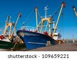 Blue Fish Boat Or Trawler In...