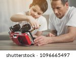 interested boy is repairing toy ... | Shutterstock . vector #1096665497