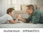 joyful man and boy are... | Shutterstock . vector #1096665521