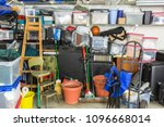 messy cluttered garage filled... | Shutterstock . vector #1096668014