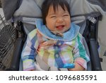 baby laughing at a stroller  10 ... | Shutterstock . vector #1096685591