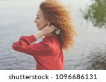 girl with curly hair. she... | Shutterstock . vector #1096686131
