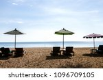 umbrella and loungers on beach... | Shutterstock . vector #1096709105
