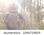 a woman with a backpack and a... | Shutterstock . vector #1096724819