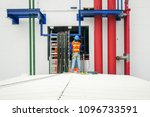 electrical worker on the roof    Shutterstock . vector #1096733591