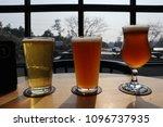 three beers infront of window | Shutterstock . vector #1096737935
