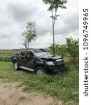Small photo of Lampang, Maemoh, Thailand - April 28, 2018: A car crash accident upside down on the wayside. The slippery road. An accident can happen at any time. Please be careful.