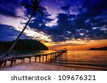 Stock photo sunset over the sea pier on the foreground 109676321