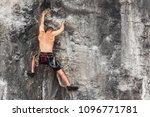 a man clambering over a rock... | Shutterstock . vector #1096771781