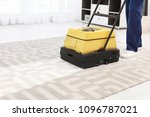 male worker with carpet cleaner ... | Shutterstock . vector #1096787021