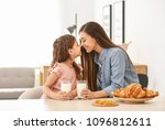 mother and daughter having... | Shutterstock . vector #1096812611
