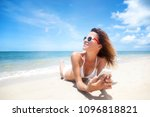 a girl in a white bikini lies... | Shutterstock . vector #1096818821