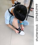 little boy trying to tying... | Shutterstock . vector #1096843949