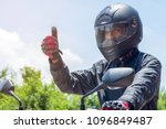 Man In A Motorcycle With Helme...