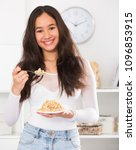young smiling girl eating... | Shutterstock . vector #1096853915