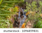 waterfall in the mountains ... | Shutterstock . vector #1096859831