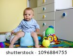 smiling baby sitting on chamber ... | Shutterstock . vector #1096884755