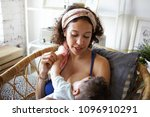 beautiful young mother wearing... | Shutterstock . vector #1096910291