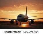 airplane at sunset   back lit | Shutterstock . vector #109696754