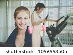 asian woman is lifting dumbbell ... | Shutterstock . vector #1096993505