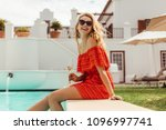 smiling woman sitting on the... | Shutterstock . vector #1096997741