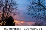 dramatic sky at sunset in the... | Shutterstock . vector #1097004791