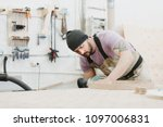 yound caucasian fabric worker... | Shutterstock . vector #1097006831