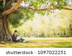 young woman reading a book... | Shutterstock . vector #1097022251