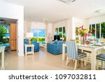 the villa is next to the sea... | Shutterstock . vector #1097032811